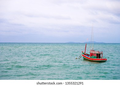 Red fishery boat on the sea