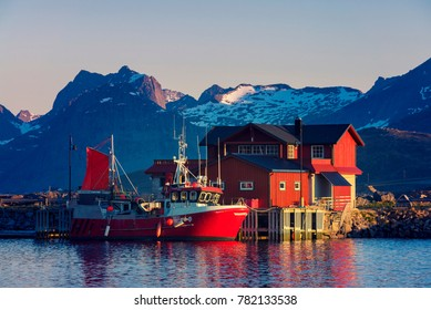 Red Fishing boats in harbor at midnight sun, Lofoten Island, Ramberg, Norway