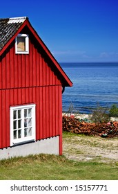 Red fishing hut with nets on the coast (Sweden)