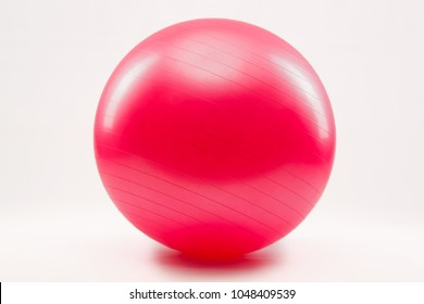 Red Fitness ball and pilate against a white background