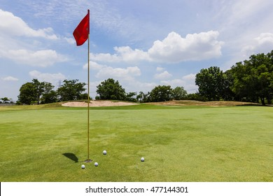Red flag - Golf ball  at the beautiful golf course of golf course