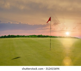 Red flag in a golf course during sunset