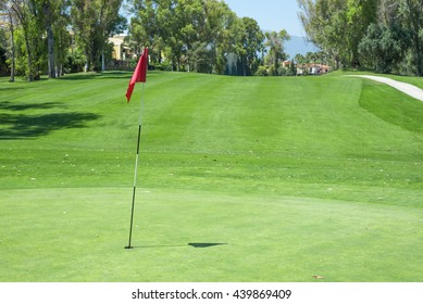 Red flag in green golf course.