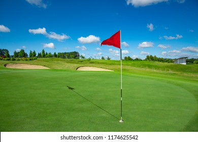 Red flag and the hole at golf club