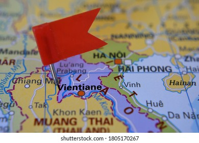 Red flag marked Vientiane on map in Laos