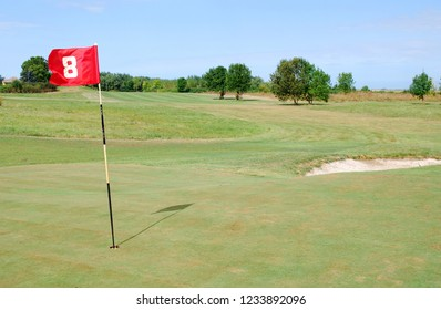 red flag number eight on golf course