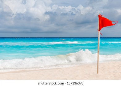 Red flag on the beach.
