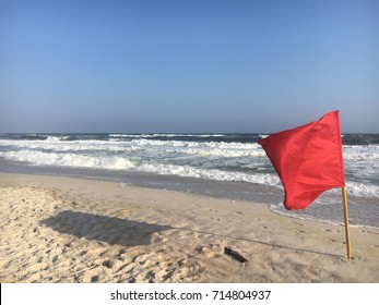 Red flag on the beach at Robert Moses State Park on Fire Island, NY.