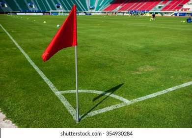 A Red flag at one corner of football stadium and soccer corner of a soccer field