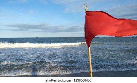 red flag warning of the danger of bathing in the sea