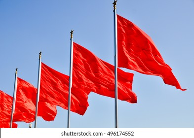 Red flags fluttering in the wind.