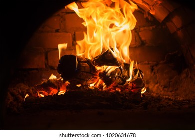 the red flame burns in a stone oven