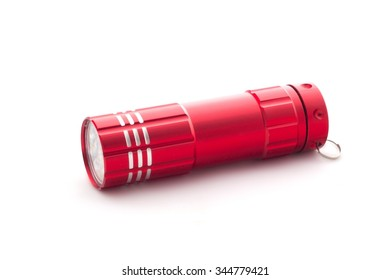 Red flashlight on a white background