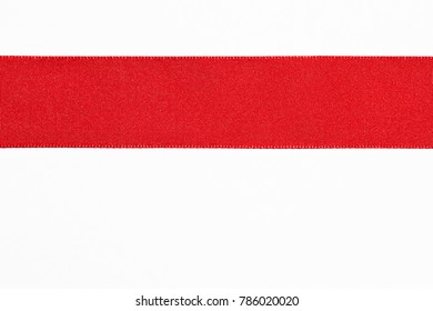 Red flat ribbon line isolated on white.