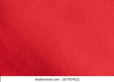 Red fleece fabric texture with gradient. Trendy background for text and design banners and posters.