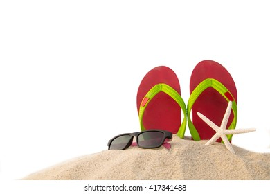 Red flip flops ,sun glass and star fish on beach in summer season.