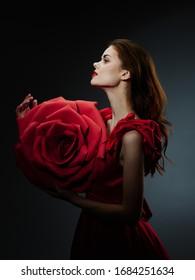 Red flower beautiful woman in evening dress