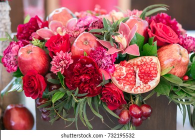red flowers with decoration and apples, white background