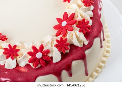 Red flowers marzipan and red glazing cake decoration design for wedding and events