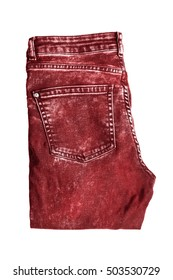 Red folded jeans isolated over white