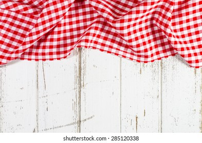Red folded tablecloth over wooden table