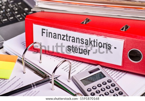 """Red folder with the german word """"Finanztransaktionssteuer"""" for  Financial Transaction Tax"""