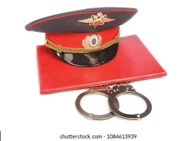 Red folder, russian police cap and handcuffs