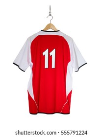 Red Football shirt no.11 hanging on hook and isolated on white background