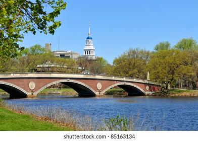 Red footbridge and blue dome of Lowell House, Harvard University. Charles River, Cambridge, Massachusetts.