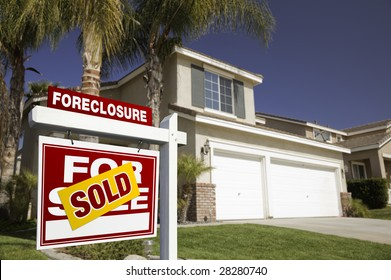 Red Foreclosure For Sale Real Estate Sign in Front of House.