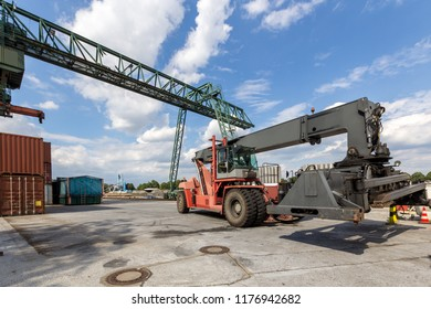 Red forklift in a container port