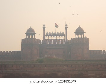 Red fort covered in smog.