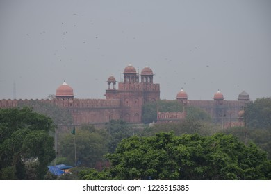 Red Fort in Delhi, India  - A UNESCO world heritage site and a former residence of the emperors of the Mughal dynasty for over 200 years. Polluted air over the city.