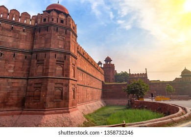 Red Fort Delhi at sunrise with moody sky. A medieval Indian fort which served as the residence of Mughal dynasty for 200 years.