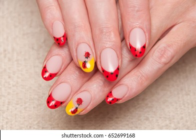 Red French manicure, Points on nails. Yellow nameless mantle. Ladybugs on nails. Oval shape of the nails.