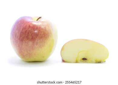 Red fresh apple quarter sliced with raw on white background