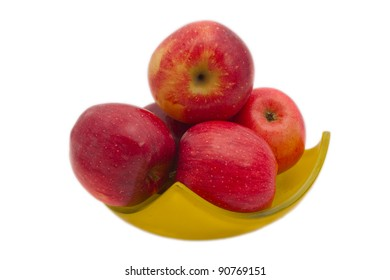 Red fresh apples in yellow bawl isolated on the white.