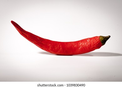 Red fresh bitter chili pepper isolated on white background