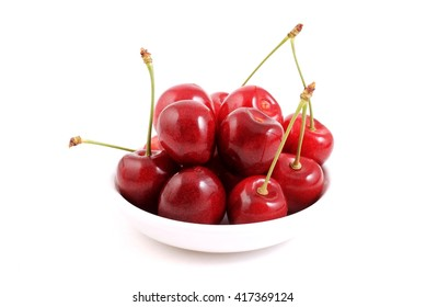 Red fresh Cherries in bowl. Fruits isolated on white background.