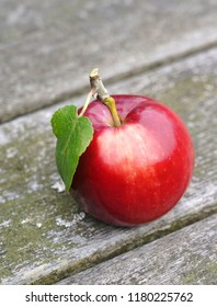 Red, fresh and organic apple on old wooden table