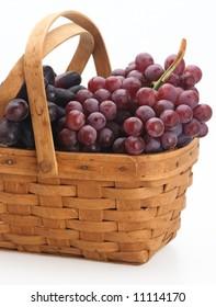 red fresh organic grape basket wood isolated
