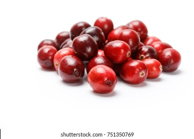 Red fresh raw cranberry isolated on white background.