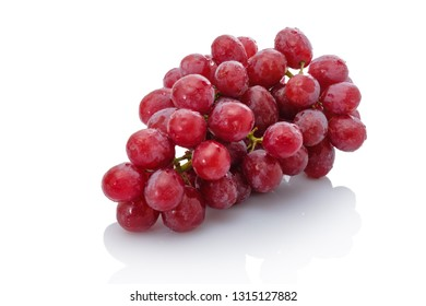 Red fresh table grapes white isolated
