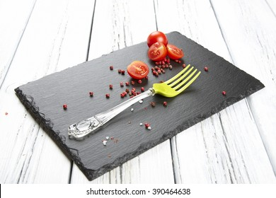 Red fresh tomatoes on chopping board with knife,shallow focus