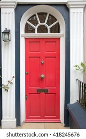 Red front Door of a Beautiful Old English Town House