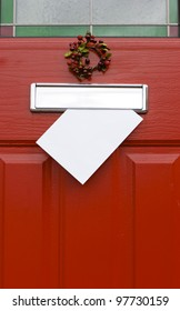 Red front door with mail (post) box and a white letter (envelope). Christmas mail concept. Space for your text.
