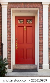 Red Front Door with White Columns and Door Frame