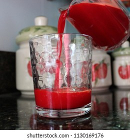 Red Fruit Drink Pouring into Glass