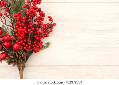 Red fruits on the branch Christmas for decoration on a wooden background