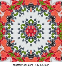 Red fruits and watermelon in mandala in white background